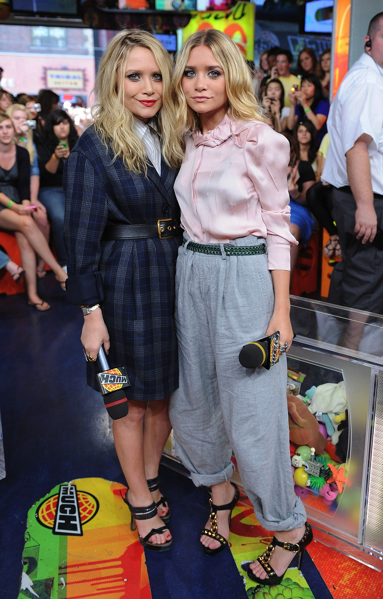 Twinning combo: Mary-Kate and Ashley exuded schoolgirl charm while visiting the MuchOnDemand TV studio in Toronto in March 2009.  Mary-Kate was made for plaid in her Elizabeth and James boyfriend jacket and python Prada sandals. Ashley tucked a blush-pink blouse into cuffed gray trousers, then slipped on her trusty Prada sandals for a touch of edge.