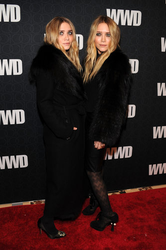 Twinning combo: The sisters jazzed up their signature all-black looks with luxe fur toppers at WWD's 100 Anniversary celebration in November 2010.  Ashley was cozy-chic in a long, fur-trimmed coat and jeweled satin pumps. Mary-Kate chose a shorter plush topper, leather skirt, and zigzag-print tights.