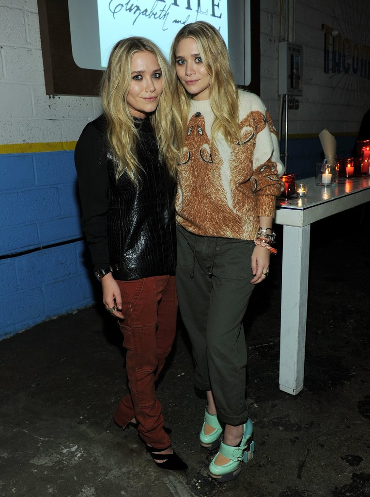 Twinning combo: The twins put their cool-girl spin on cargo pants at a Textile Elizabeth and James celebration in 2011.  Mary-Kate opted for a Fall-friendly palette wearing a black crocodile sweater with rust-hued pants and pointed pumps. Ashley went cheeky in a fox-print sweater, cuffed army-green pants, and futuristic mint Mary Janes.
