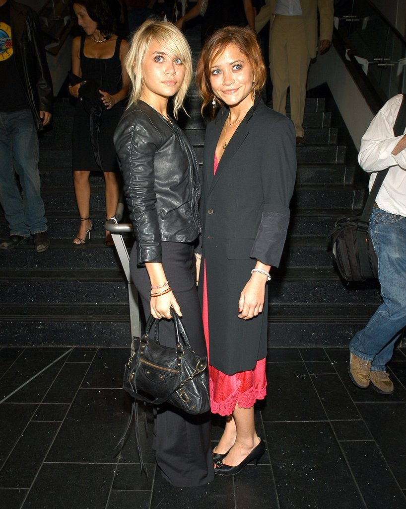 Twinning combo: Both girls fused feminine separates with a dash of menswear flair at Coty's 100th anniversary celebration in New York City.  Ashley's supple leather jacket roughed up her sweet updo and fitted black trousers. Mary-Kate cuffed a long black coat over a red, lace-trim slip dress.