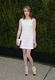 Emma Roberts was fresh and flirty in a little white waffle-knit dress, strappy pumps, and a white clutch, all by Chanel, fittingly at a Chanel dinner held in LA.