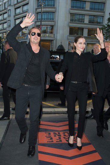 Angelina Jolie arrived hand in hand with Brad Pitt at the Paris premiere, both showing off their respective menswear styles.