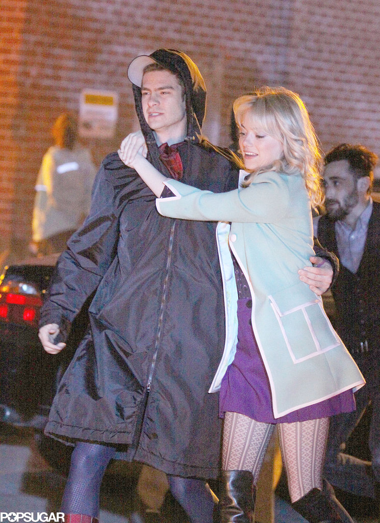 Emma Stone held on to Andrew Garfield after filming a rescue scene in NYC on their The Amazing Spider-Man 2 set in NYC.