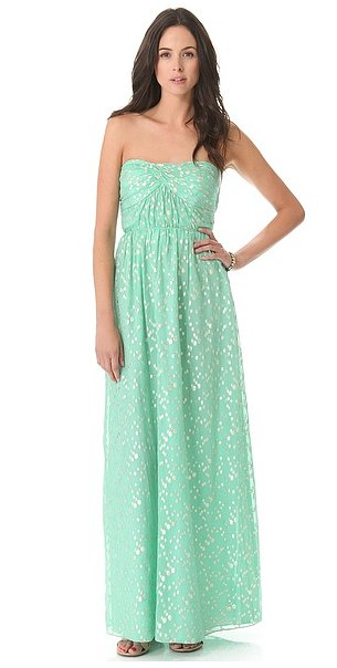 You will undoubtedly look pretty in this Shoshanna strapless maxi dress ($495), especially with breezy waves and braids to match.