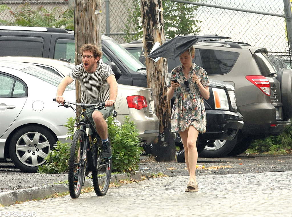 Michelle Williams walked while Dustin Yellin rode his bike through the rain.