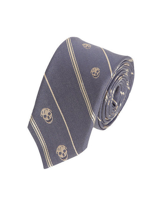 Introduce him to designer clothing with baby steps. An Alexander McQueen skull tie ($185) today, a bespoke tux tomorrow.