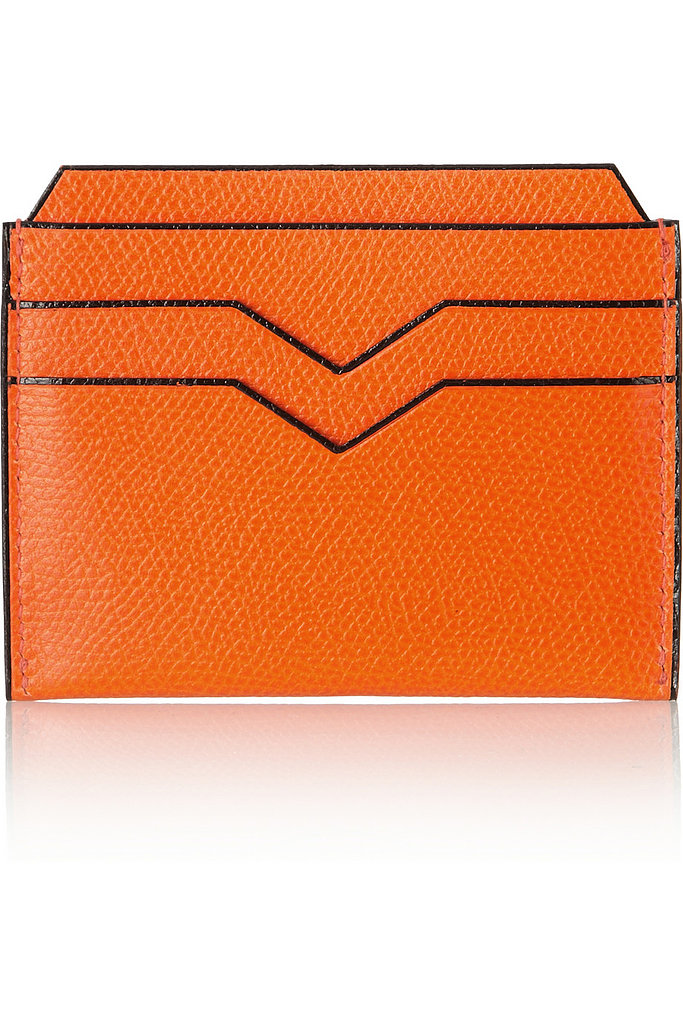 While men are left out of the statement bag phenomenon (for the most part), they do have opportunities for some major accessory moments. Valextra's textured leather card holder ($240) will send a stylish message when pulled out to pay at date night. . .or the grocery store.