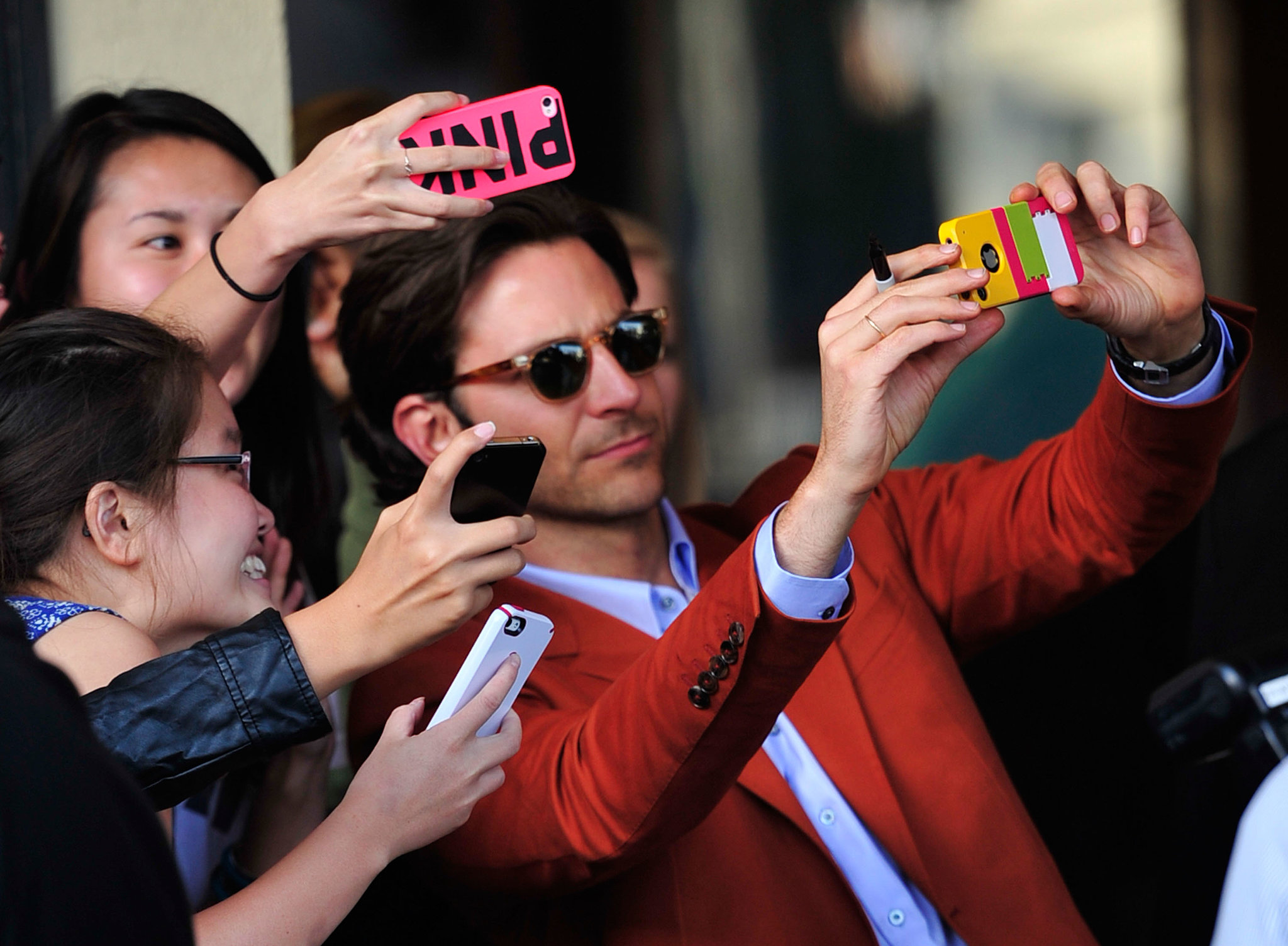 Bradley Cooper was more than comfortable surrounded by camera phones at the LA premiere of The Han