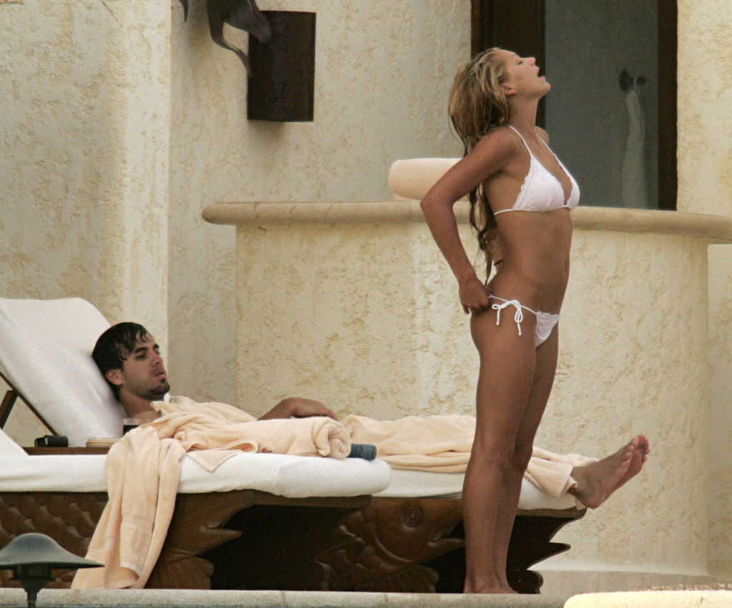 Anna Kournikova flaunted her figure in a white bikini during an October 2004 trip to Mexico with Enrique Iglesias.