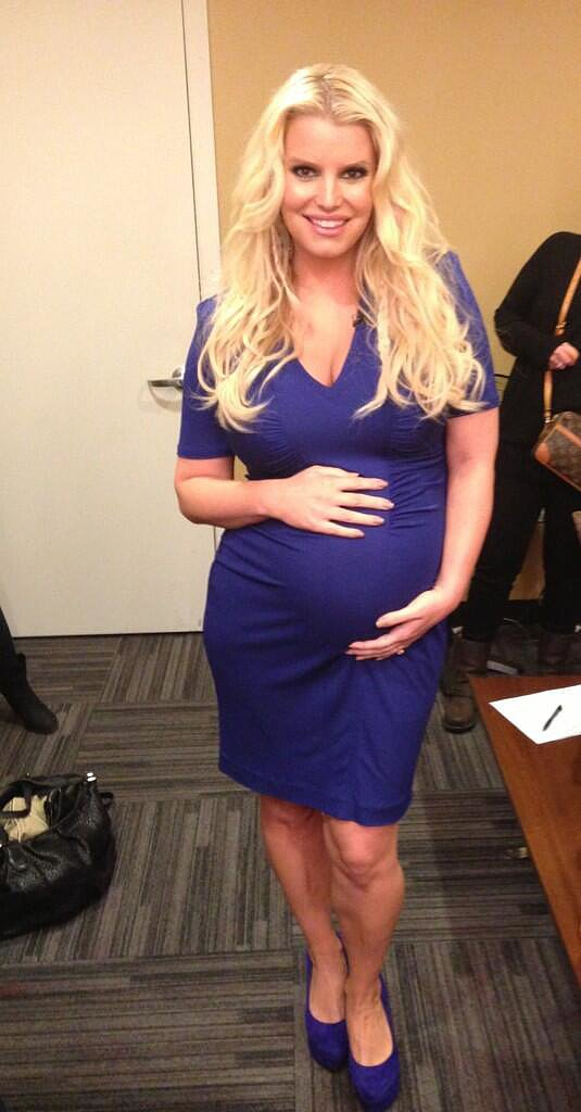 Jessica Simpson dressed her bump in purple for an interview on The Ellen DeGeneres Show in March.  Source: Twitter user JessicaSimpson