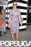 Molly Sims juxtaposed a feminine floral Zara dress with cool Ray-Ban aviator sunglasses, then added a classic finish with black pointy pumps.