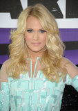 With her blond hair curled in a Farrah Fawcett fashion, Carrie Underwood held true to the country belief that the bigger the hair the better. Her eye makeup was equally eye-catching with silver glitter and extra lashes.