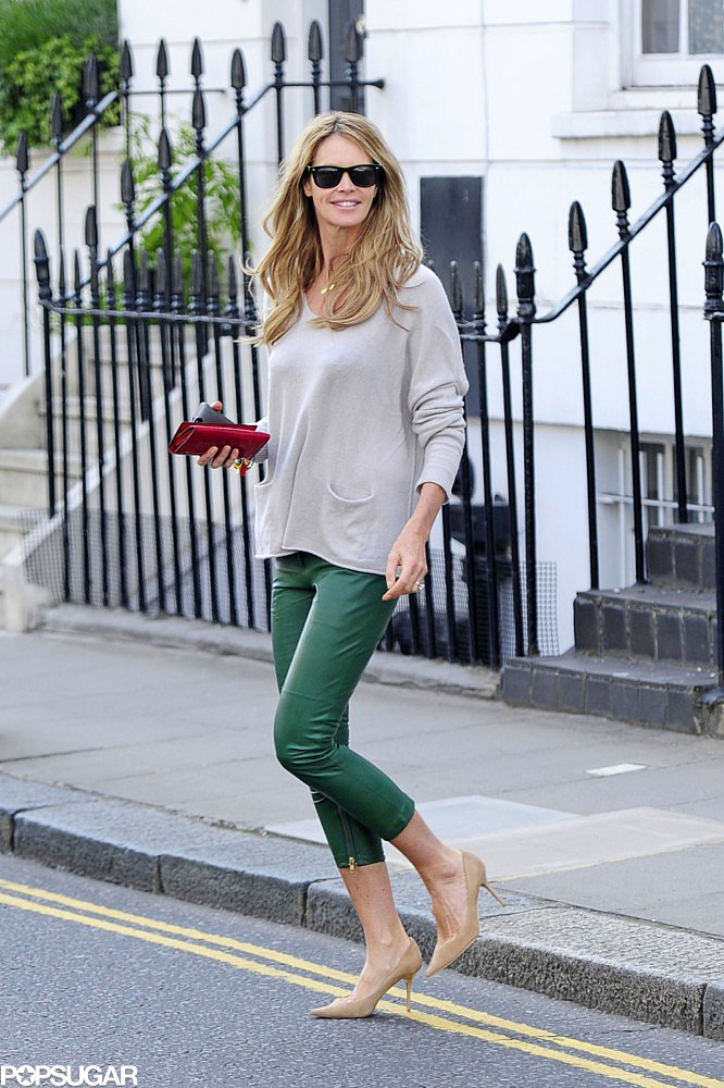 Elle Macpherson colored the streets of London in her green leather cropped pants.