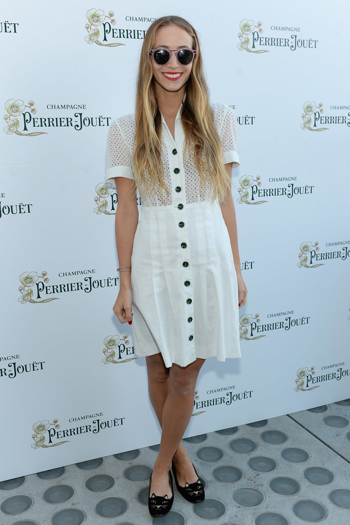 Harley Viera-Newton paired a little white shirtdress with black cat flats and round sunglasses at a party in NYC.