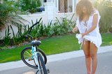 Beyoncé rode her bike in a white bikini. Source: Beyoncé Knowles