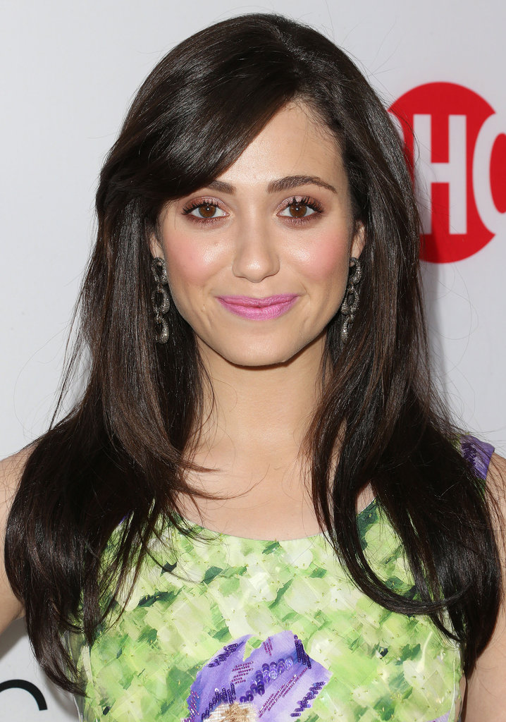 Emmy Rossum's straightened, dark locks and pink lips.