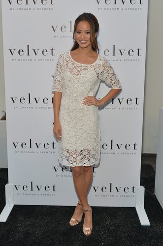 At the Velvet store opening in LA's Brentwood neighborhood, Jamie Chung was entirely feminine in this Lily Aldridge for Velvet lace dress ($150) with gold ankle-strap sandals.