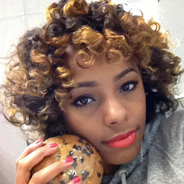 Curly highlights, bold lips, and a half-moon manicure make this look an all-around win. Source: Instagram user beautybytisha