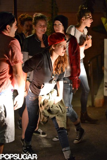 Kristen Stewart wore a red baseball hat.