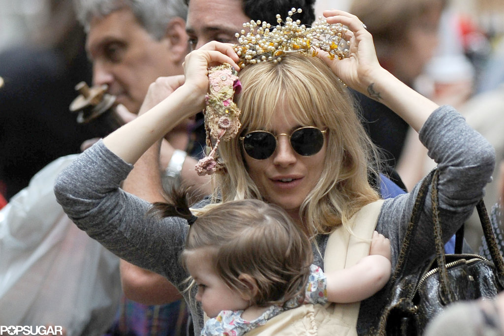 Sienna Miller tried on a flower crown.
