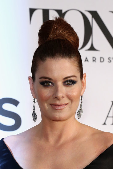 Debra Messing opted for a dramatic eyebrow and smoky eye pairing. She completed the look with a voluminous topknot.