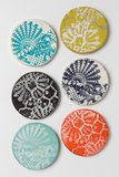 Bring the feel of the ocean home with cool coasters ($6).