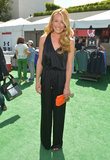 Cat Deeley showed how to make a fancy black jumpsuit daytime appropriate: just add a bright clutch and aviator sunglasses.