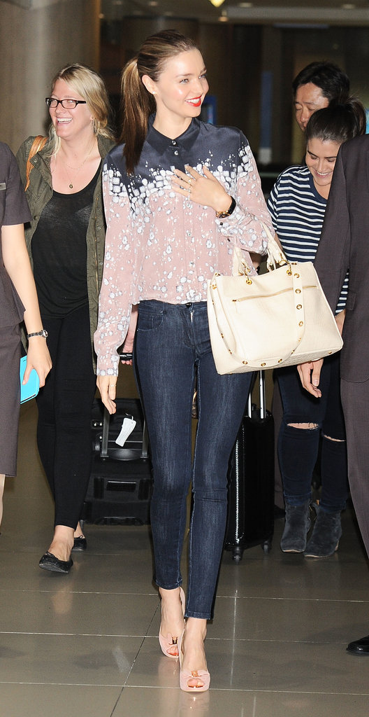Miranda Kerr arrived in South Korea looking polished in a printed button-down, skinny denim, and nude peep-toe pumps.