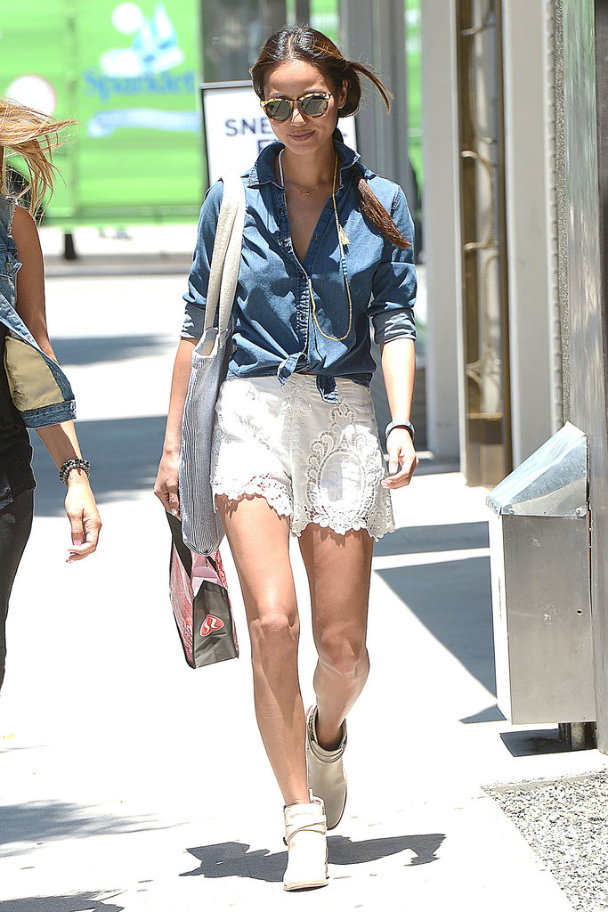 Jamie Chung paired a denim blouse with lace shorts, creating a fashionable mix while shopping in LA.