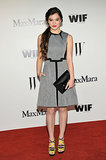 The guest of honor, Hailee Steinfeld, looked perfectly chic in a Sportmax gray and black sheath and bright strappy heels.