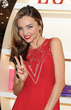 Miranda Kerr flashed a peace sign.
