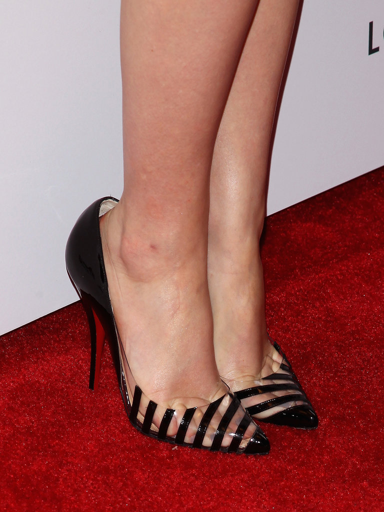 A closer look at Emma's feet revealed a cool clear component to her striped pumps.