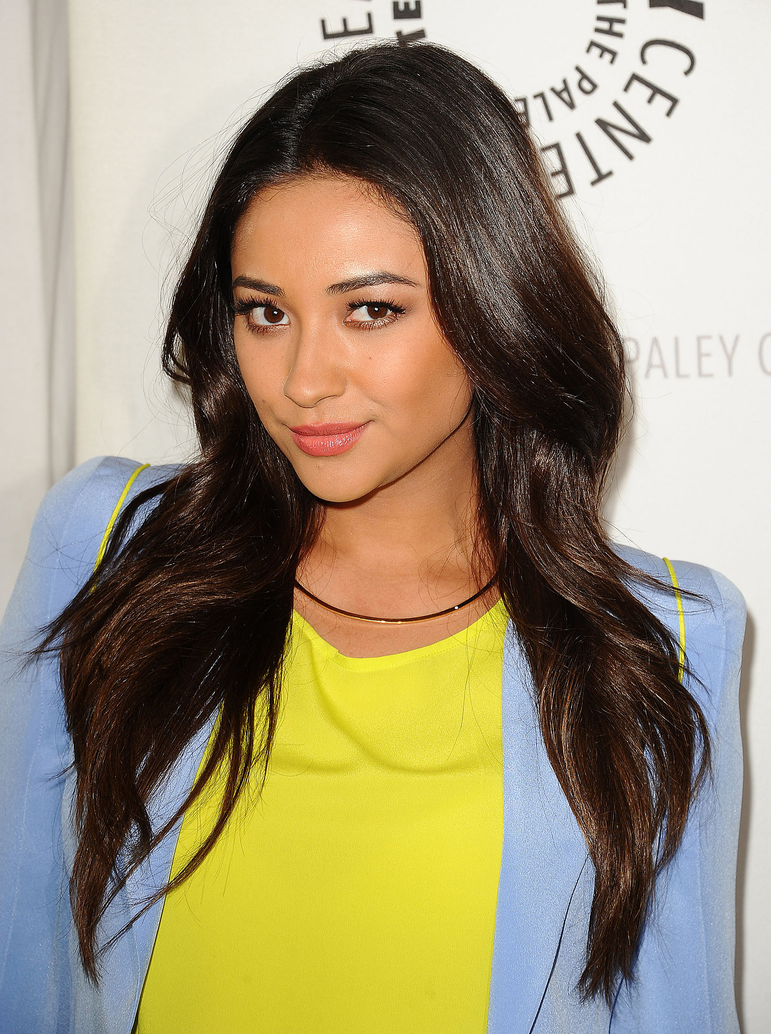 Shay Mitchell wore barely there waves. The look is easy to create by making subtle bends in your hair with a curling iron. Try wrapping your hair around the barrel with your hands to get the casual look.
