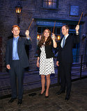 Kate Middleton had fun with Prince Harry and Prince William when the royals toured a Harry Potter set at Warner Bros. Studios in London on April 26.