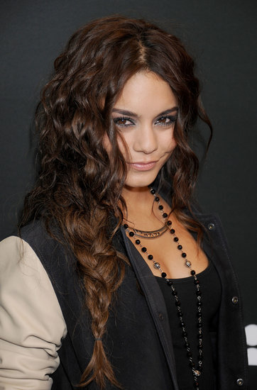 A totally textured braid and metallic eye makeup were the highlights of Vanessa Hudgens's beauty look.