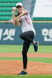 Miranda Kerr fired one past home plate during a baseball game in Seoul, South Korea, in June.