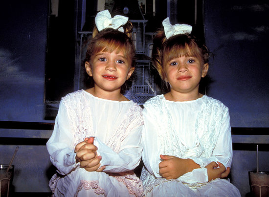 Back in 1993, Mary-Kate and Ashley were living up their fame as Michelle Tanner on Full House. The pair was spotted at Planet Hollywood in coordinated pink and white outfits with blunt bangs, high ponytails, and big bows.