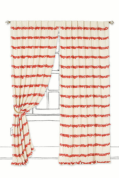 Reminiscent of a vintage find, pompoms give these striped curtains ($118-$178) an eclectic twist.