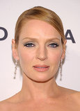 Uma Thurman's classic updo and inky blue liner made for an elegant look at the amfAR Inspiration Gala.