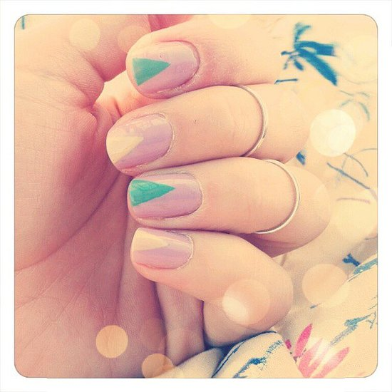 Jazz up a pastel manicure with a simple triangular design. Source: Instagram user petiteandco
