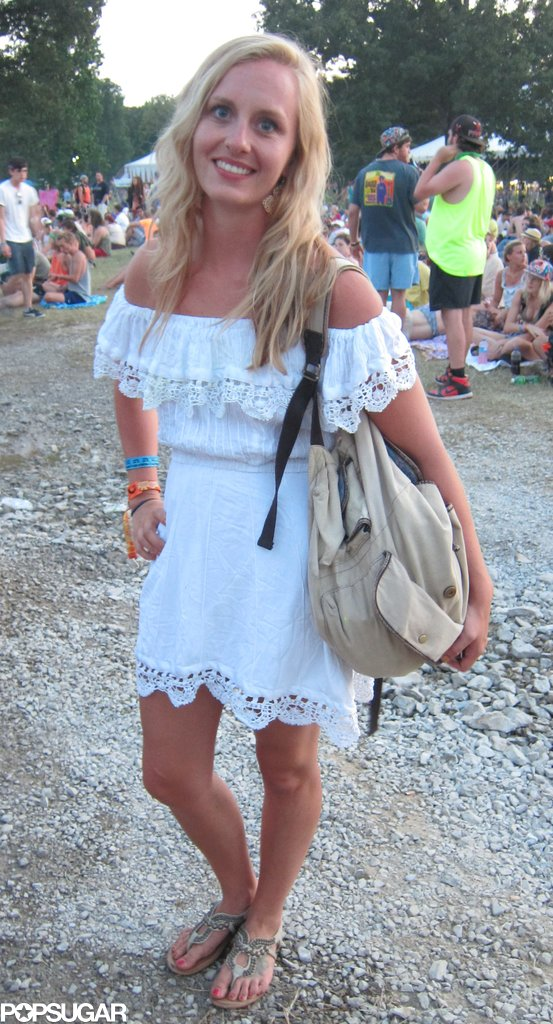 A flirty off-the-shoulder LWD got a boyish tilt, thanks to this festivalgoer's old-school backpack.