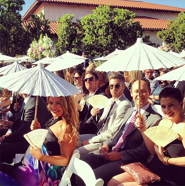 CaCee Cobb and Dave Annable tried to keep cool in San Diego during Kathryn Sykora and Chris Hetherington's ceremony in June 2013.  Source: Instagram user asands78
