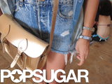 Maddie's structured satchel and silver accessories were the chicer contrast to her ripped denim cutoffs.