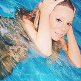 "Mariah Carey shared this photo of herself taking a ""much needed splash."" Source: Instagram user mariahcarey"