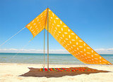 Keep the whole family under cover with Scenario Home's UV-protected Beach Umbrella ($195) in cheery yellow and white.