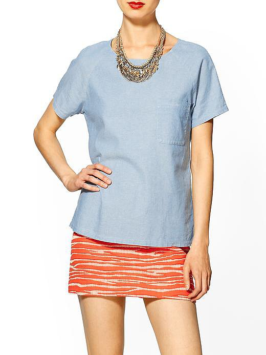 The dressed-up way to do chambray is with this Hive & Honey chambray tee ($30, originally $49) and a great statement necklace.