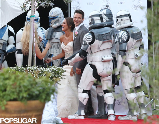 Matt Lanter and Angela Stacy posed for photos with robots.