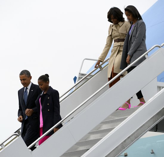 Michelle Obama looked sophisticated in a Burberry trench coat while deplaning in Belfast.