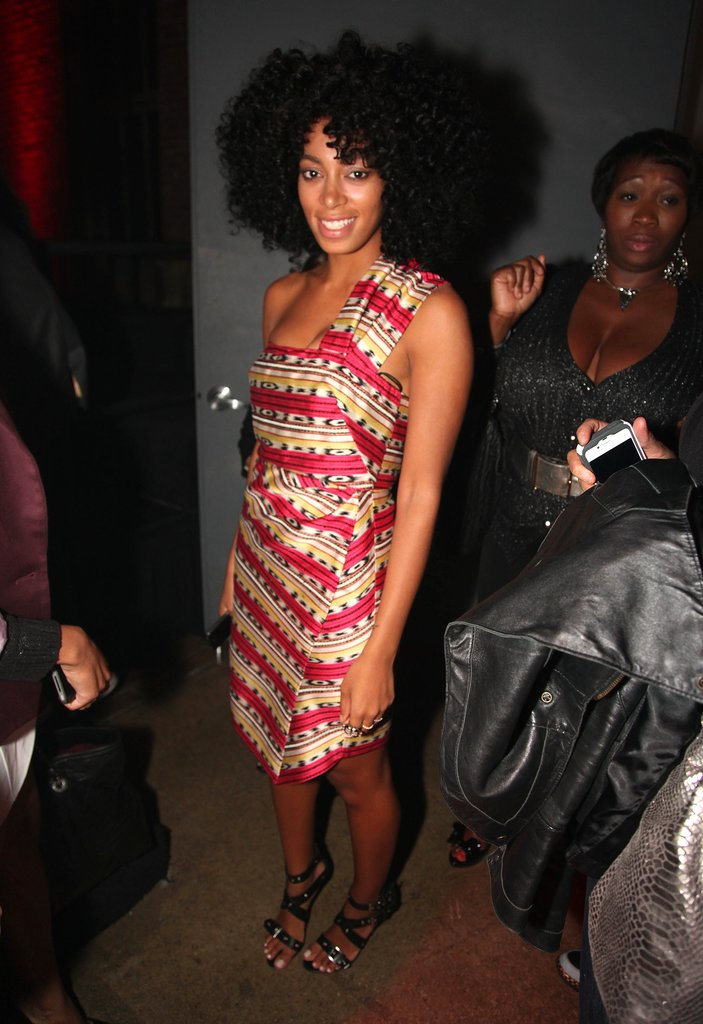 Solange Knowles posed in a batik-print one-shoulder creation and buckle-detail sandals at an April 2012 Hennessy party in NYC.