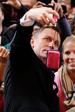 Daniel Craig held onto a camera for a fan while at an event in Australia in November 2012.